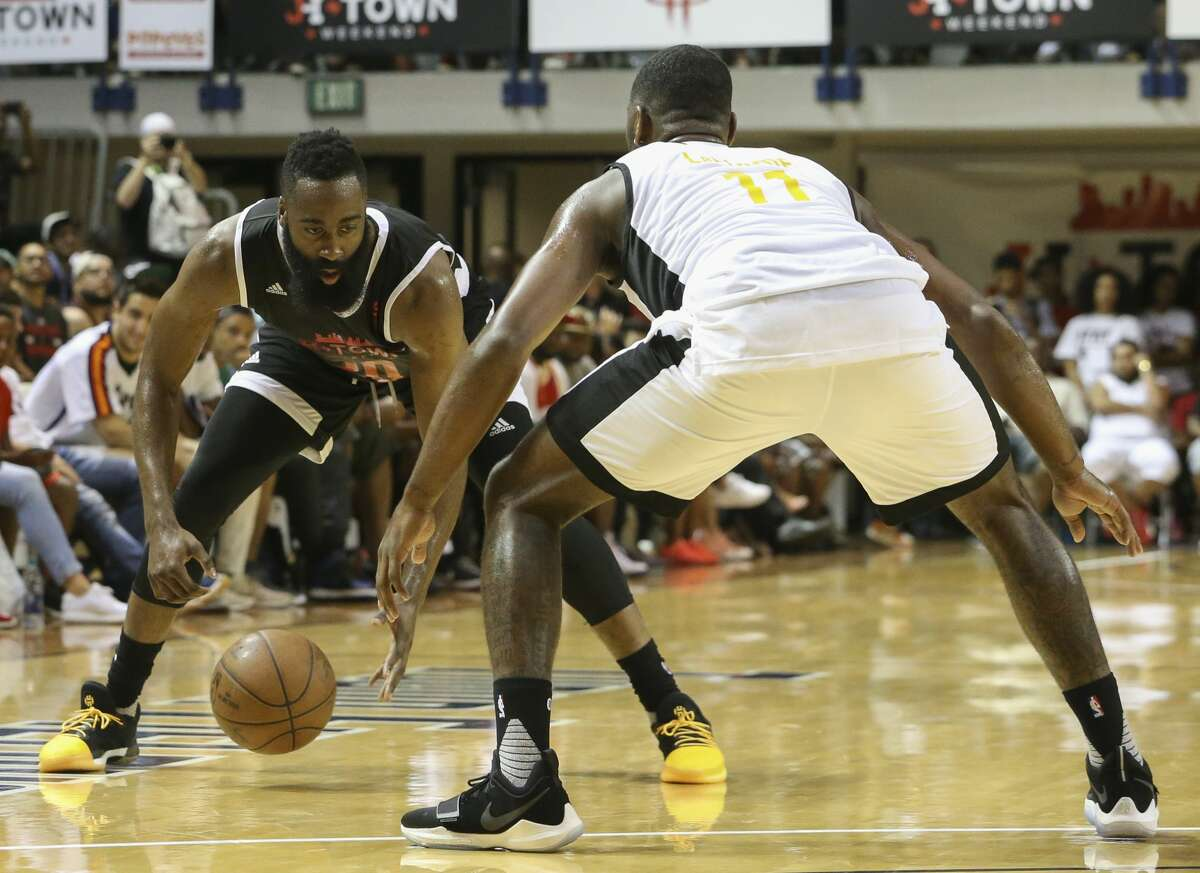 Big Tony's James Harden shows off his dribbling skills while La Flame's Isaiah Taylor is defensing during the NBA game of James Harden charity basketball tournament at Rice University's Tudor Field House Sunday, Aug. 20, 2017, in Houston. ( Yi-Chin Lee / Houston Chronicle )