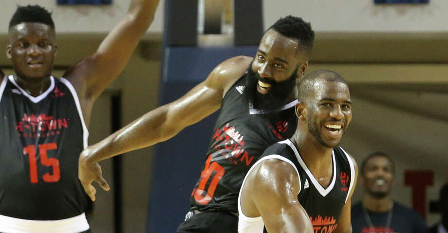 Big Tony's Chris Paul (3) celebrates with James Harden after scoring a big slam dunk with Harden's assist during the NBA game of James Harden charity basketball tournament against La Flame at Rice University's Tudor Field House.See more images from the star-studded tournament. Photo: Yi-Chin Lee/Houston Chronicle