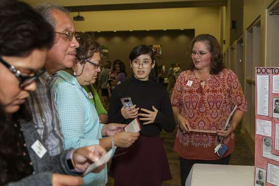 Zoe Castillo, 16, discussing  her exhibit about medical experiments performed during the holocaust as part of the Holocaust Study Seminar Open House at the Harry & Jeanette Weinberg Campus of the San Antonio Jewish Community, Sunday, August 20, 2017. Castillo was one of eight high school students who participated in the six month study program and a 12 day trip to Eastern Europe, at the end of the trip each student created an exhibit based on their experience.