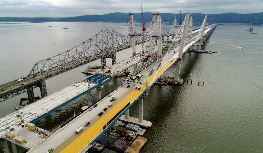 FILE- In this July 25, 2017, file photo, construction continues on the spans of the new Governor Mario M. Cuomo Bridge, right, as vehicles make their way on the the Tappan Zee Bridge over the Hudson River, near Tarrytown, N.Y. One of the largest public infrastructure projects underway in the U.S. is about to begin carrying traffic across a broad expanse of the Hudson River. Westbound travelers will be switched from the old Tappan Zee Bridge to the first span of the $4 billion Gov. Mario M. Cuomo Bridge on Friday, Aug. 25 (AP Photo/Julie Jacobson, File) ORG XMIT: NYR204 Photo: Julie Jacobson / Copyright 2017 The Associated Press. All rights reserved.