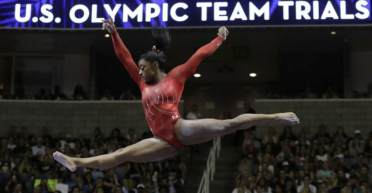 FILE - In this Sunday, July 10, 2016, file photo, Simone Biles competes on the balance beam during the women's U.S. Olympic gymnastics trials in San Jose, Calif. Biles, who won four gold medals at the 2016 Summer Games, says she is just testing the waters as she considers a return to competition. The 20-year-old has spent the year since Rio de Janeiro taking a break from the sport and says she is in no hurry to make any sort of concrete decision. (AP Photo/Gregory Bull, File)