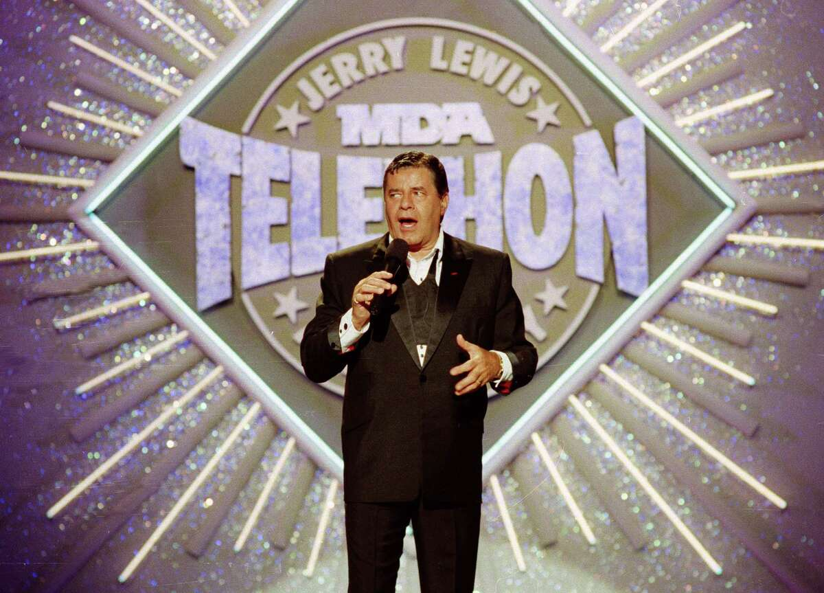 Jerry Lewis hosts the 25th Anniversary of the Jerry Lewis MDA Labor Day Telethon fundraiser in 1990. The telethon raised $2 billion over 40 years with Lewis as host.