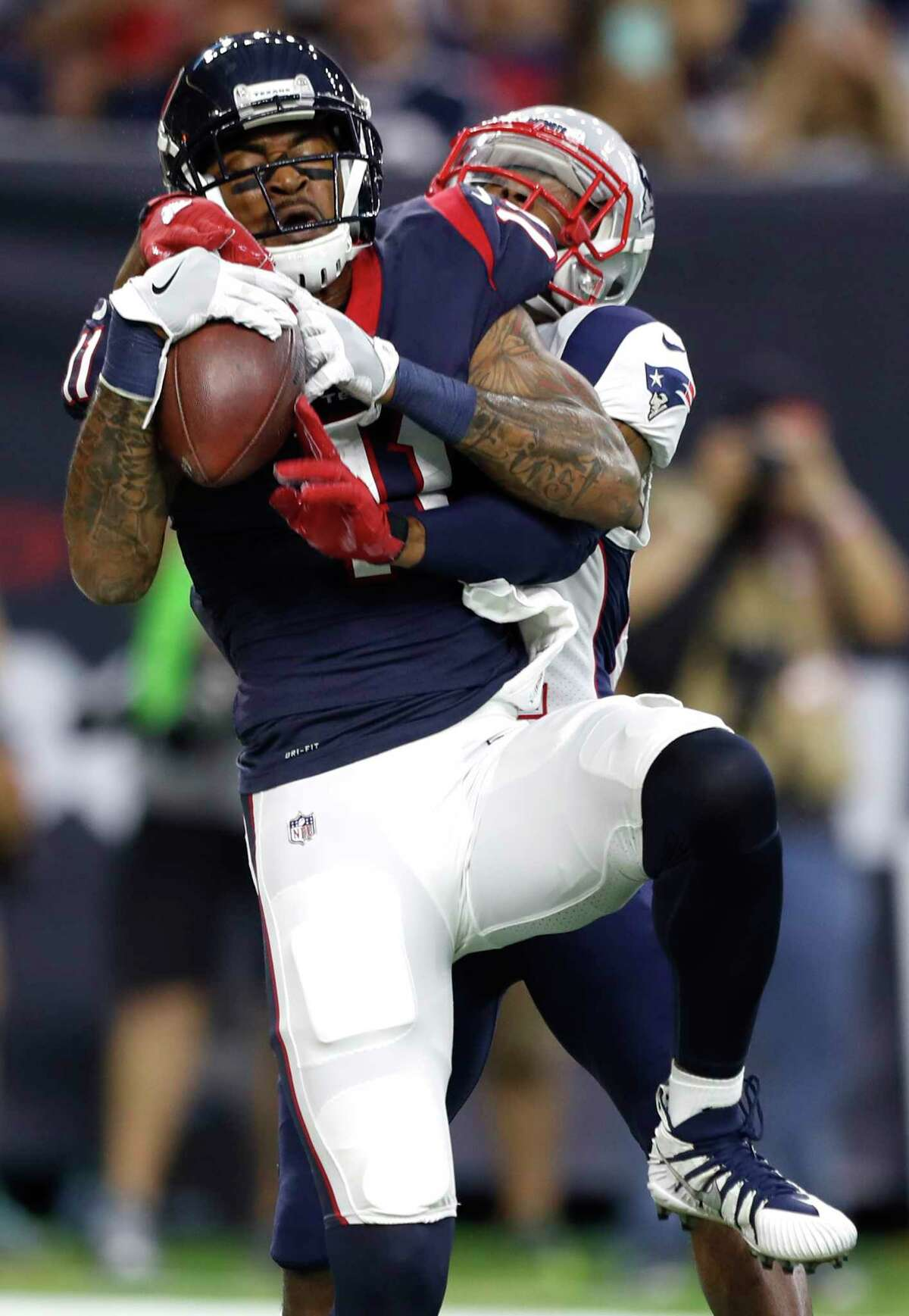 Texans wide receiver Jaelen Strong (11) gets the better of Patriots cornerback Malcolm Butler on a 2-yard TD catch Saturday night at NRG Stadium.