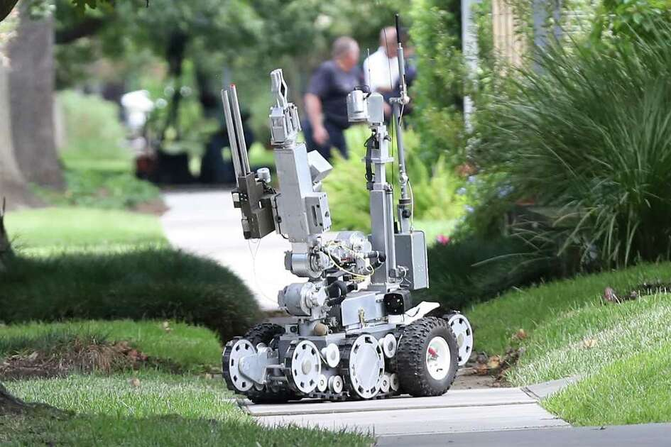 """A robot was used as the Houston Police, ATF and the FBI responded to a """"special assignment"""" in the 2000 block of Albans Sunday, Aug. 20, 2017, in Houston."""