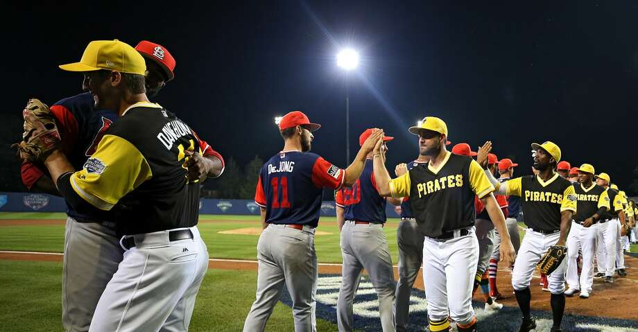 WILLIAMSPORT, PA - AUGUST 20: The Pittsburgh Pirates and the St. Louis Cardinals shake hands following the inaugural MLB Little League Classic at BB&T Ballpark at Historic Bowman Field on August 20, 2017 in Williamsport, Pennsylvania. (Photo by Patrick Smith/Getty Images) Photo: Patrick Smith/Getty Images
