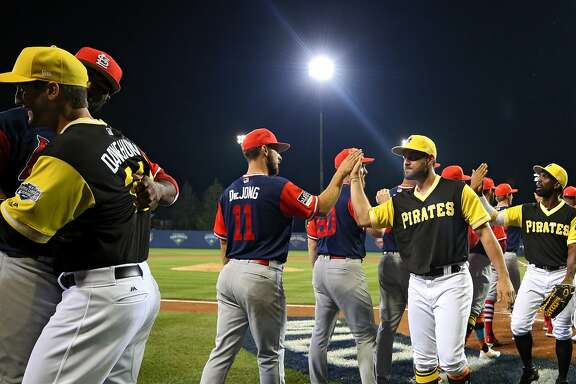 WILLIAMSPORT, PA - AUGUST 20: The Pittsburgh Pirates and the St. Louis Cardinals shake hands following the inaugural MLB Little League Classic at BB&T Ballpark at Historic Bowman Field on August 20, 2017 in Williamsport, Pennsylvania. (Photo by Patrick Smith/Getty Images)