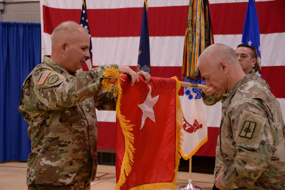 New York Army National Guard Newly promoted Maj. Gen. Gen, Raymond Shields, left, unfurls his two star general officer?s flag with Command Sgt. Major David Piwowarski after Shield?s promotion ceremony in Latham.