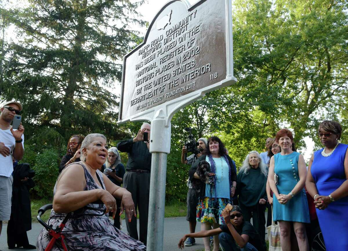 Beverly Bardequez, foreground, the president of the Rapp Road Historical Association, addresses those gathered for the unveiling of a plaque during the Rapp Road community's 60th Family Reunion Weekend on Sunday, Aug. 20, 2017, in Albany, N.Y. (Paul Buckowski / Times Union)
