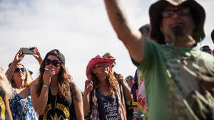 The crowd cheers at the MainStage as the clock hits 4:20 during Hempfest at Myrtle Edwards Park on Sunday, Aug. 20, 2017.