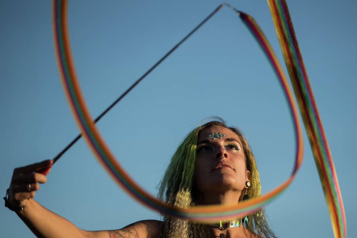 Luna Waya twirls a ribbon at the main stage during Hempfest at Myrtle Edwards Park on Sunday, Aug. 20, 2017.
