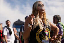 A woman smokes at the main stage during Hempfest at Myrtle Edwards Park on Sunday, Aug. 20, 2017.