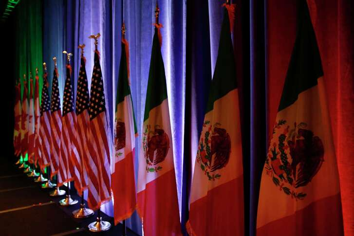 The flags of Canada, the U.S. and Mexico are lit by stage lights before a news conference, Wednesday, Aug. 16, 2017, at the start of NAFTA renegotiations in Washington. (AP Photo/Jacquelyn Martin)