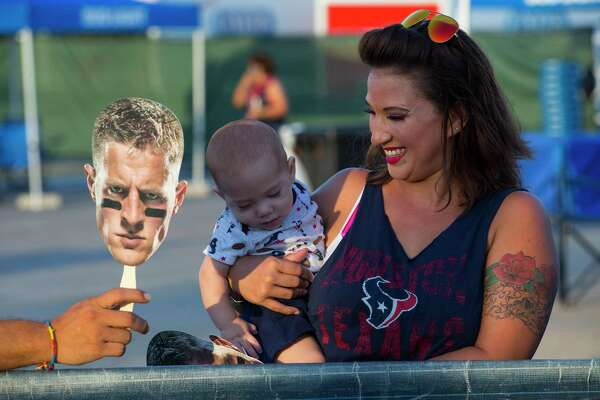 Houston Texans fan Niki Benigar holds her baby, Branik Ganbdara as she waits for players to arrive to the first of two open practices of training camp at The Methodist Training Center on Monday, Aug. 21, 2017, in Houston.