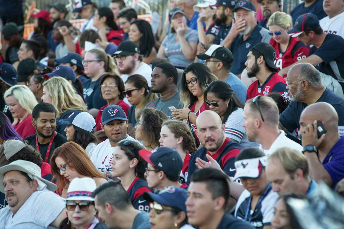 Houston Texans fans arrive to the first of two open practices of training camp at The Methodist Training Center on Monday, Aug. 21, 2017, in Houston.
