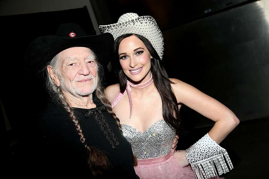 Willie Nelson and Kacey Musgraves pose backstage at ACL Live on Dec. 31, 2015, in Austin. Photo: Gary Miller/Getty Images