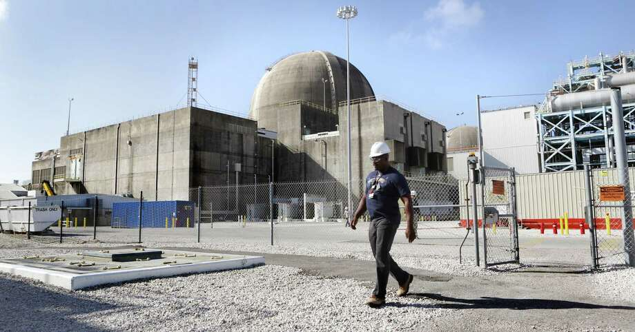 An employee walks by one of the reactors at the South Texas Nuclear Project Electric Generating Station. The two reactors were granted operating license extensions Thursday, which will allow them to run into the 2040s.  An employee walks past the nuclear reactors at South Texas Nuclear Generating Station which is located near Bay City, TX on Wednesday, Jan. 11, 2017. Photo: Bob Owen /San Antonio Express-News / ©2017 San Antonio Express-News