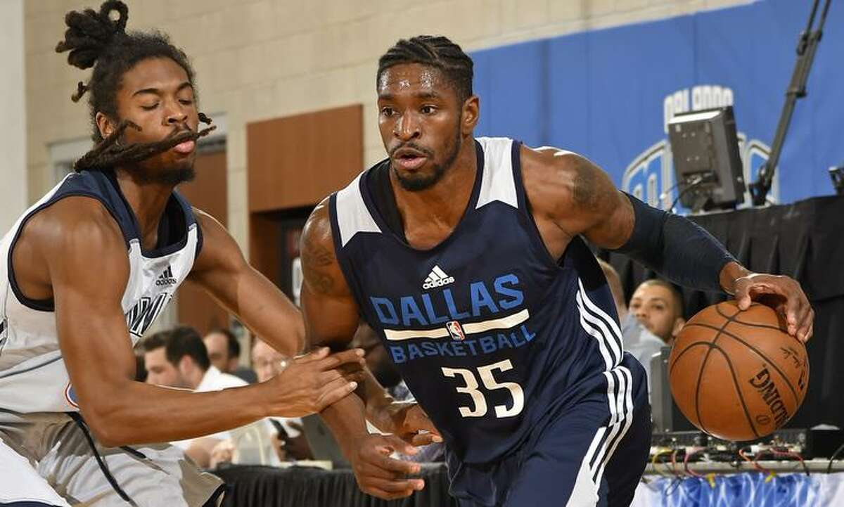 Guard Brandon Paul dribbles up the court during and NBA Orlando Summer League game in July 2017 as a member of the Dallas Mavericks.