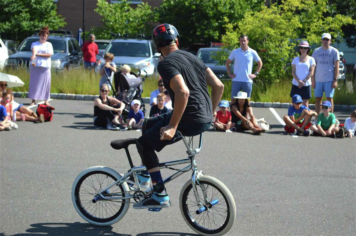 """Kevin """"K-Rob"""" Robinson turns it around at the BMX Bike Show at Darien Library on Saturday, Aug. 19, 2017, in Darien, Conn."""