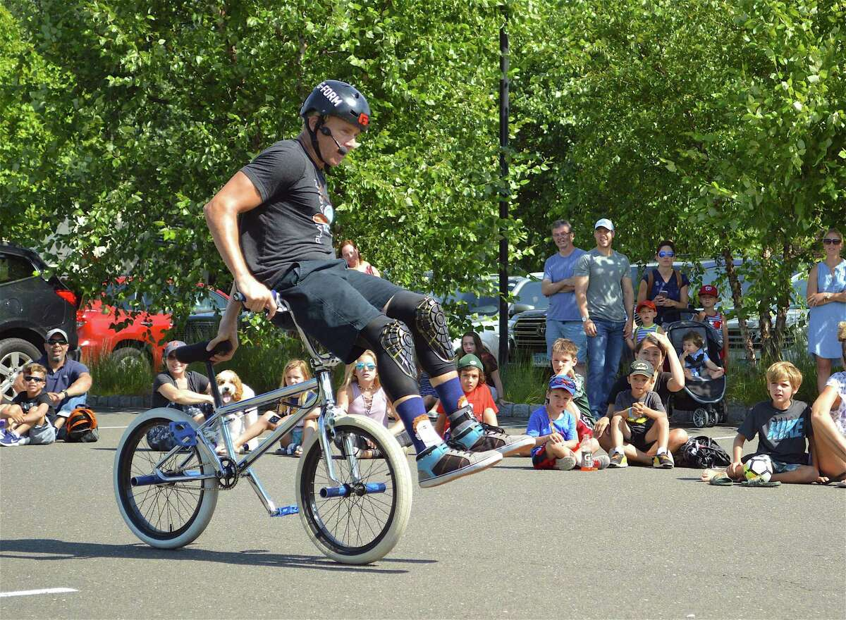 """The crowd was fascinated by the feats and positive message of Kevin """"K-Rob"""" Robinson at the BMX Bike Show at Darien Library on Saturday, Aug. 19, 2017, in Darien, Conn."""