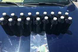 Jefferson County Sheriff's deputies collected 18 bottles of suspected codeine and various other drugs during a traffic stop on Highway 10 on Saturday, Aug. 19, 2017.