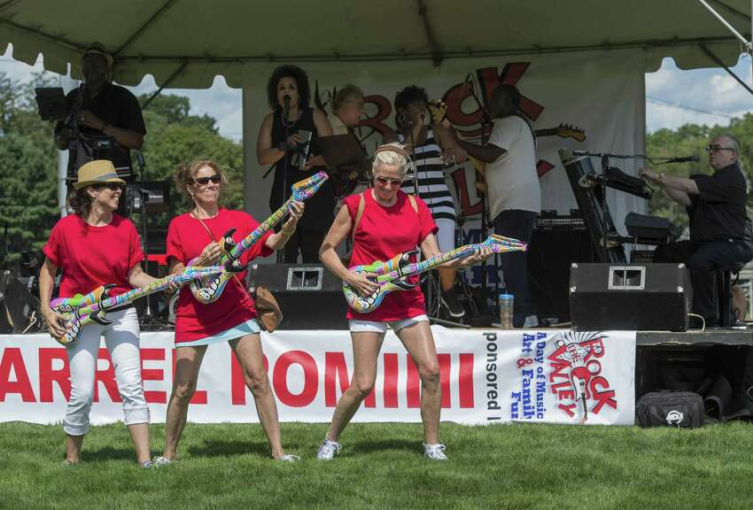 From left, the Nicolari sisters - Patty, Lisa and Lynne rock out with the band the Bernadettes at the annual