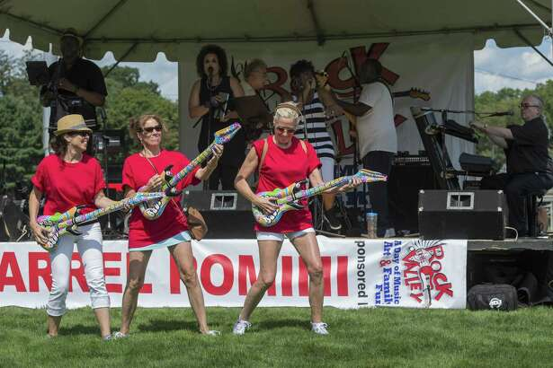 "From left, the Nicolari sisters — Patty, Lisa and Lynne rock out with the band the Bernadettes at the annual ""Rock The Valley"" festival at Nolan Field in Ansonia on Saturday."