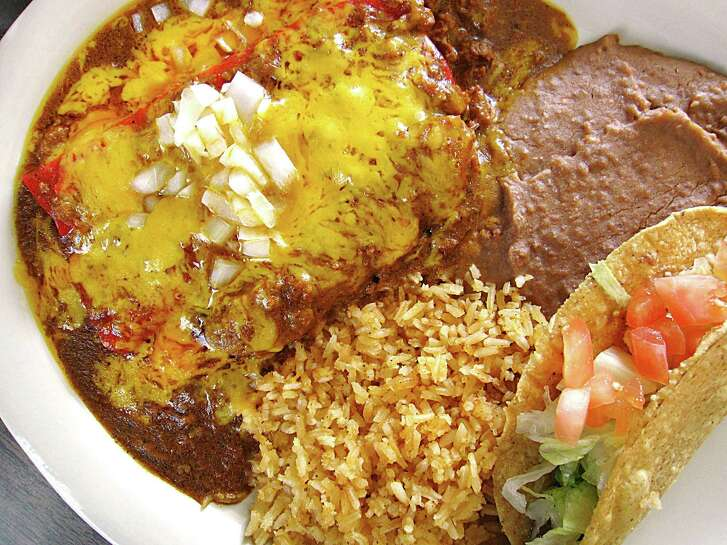 A #1 Mexican Dinner with cheese enchiladas, chile con carne gravy, a tamale, rice, beans and a crispy beef taco from Garcia's Mexican Food on Fredericksburg Road in San Antonio.