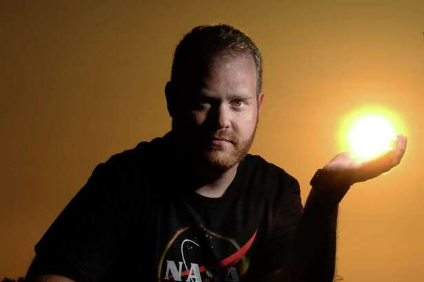 A hobby astronomer and documentarian, Will Young plans to travel to Wyoming to witness the total solar eclipse on Monday. Young is pictured in Beaumont with the setting sun in the background.  Photo taken, Sunday, August 13, 2017 Guiseppe Barranco/The Enterprise