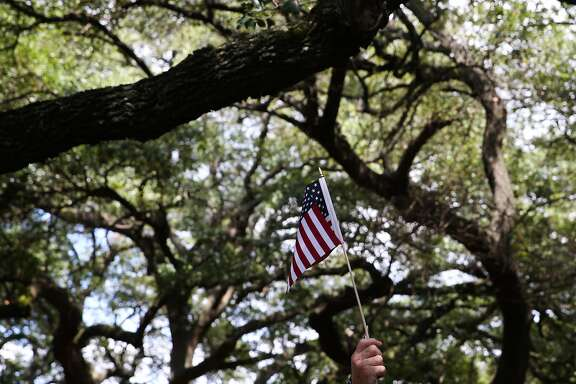Black Lives Matter supporters bring out American flags to protest Spirit of the Confederacy statue at Sam Houston Park on Saturday, August 19, in Houston. ( Yi-Chin Lee / Houston Chronicle)