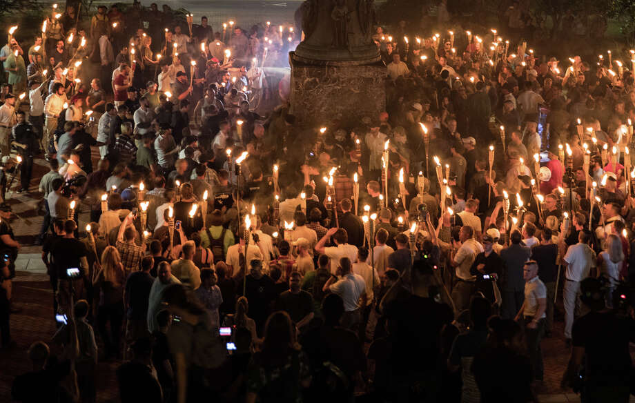 """Chanting """"white lives matter!"""" and """"Jews will not replace us!"""" hundreds of neo-Nazis and white supremacists carried torches across the University of Virginia campus Aug. 11. Photo: Evelyn Hockstein, The Washington Post. / Evelyn Hockstein"""