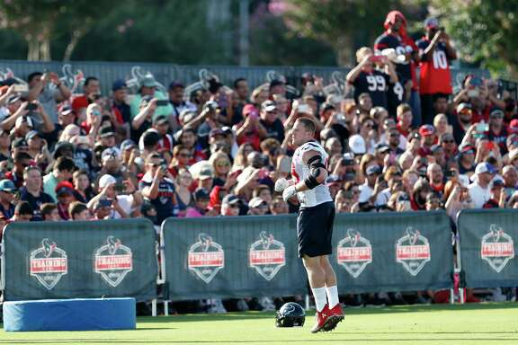 Houston Texans defensive end J.J. Watt warms up in front of the home fans during training camp at The Methodist Training Center on Monday, Aug. 21, 2017, in Houston.