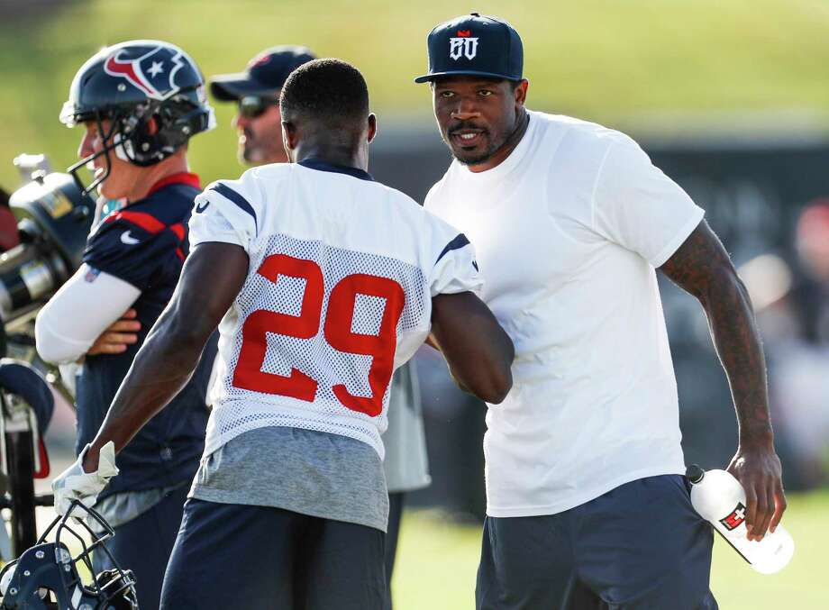 Former Houston Texans wide receiver Andre Johnson is greeted by free safety Andre Hal (29) as he arrives to practice during training camp at The Methodist Training Center on Monday, Aug. 21, 2017, in Houston. Photo: Brett Coomer, Houston Chronicle / © 2017 Houston Chronicle}