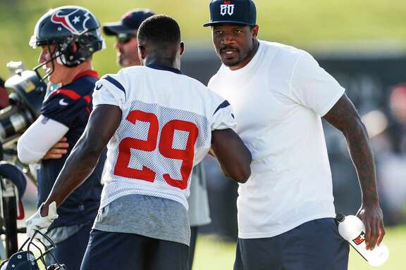 Former Houston Texans wide receiver Andre Johnson is greeted by free safety Andre Hal (29) as he arrives to practice during training camp at The Methodist Training Center on Monday, Aug. 21, 2017, in Houston.