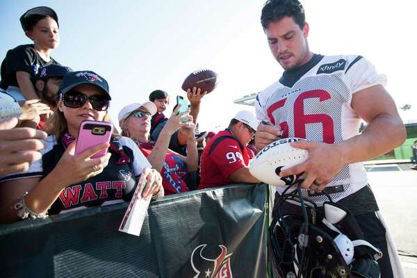 Houston Texans inside linebacker Brian Cushing (56) signs autographs during training camp at The Methodist Training Center on Monday, Aug. 21, 2017, in Houston.