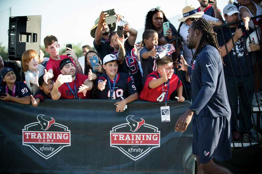 Houston Texans defensive end Jadeveon Clowney, right, slaps hands with fans as he walks to practice during training camp at The Methodist Training Center on Monday, Aug. 21, 2017, in Houston. Photo: Brett Coomer, Houston Chronicle / © 2017 Houston Chronicle}