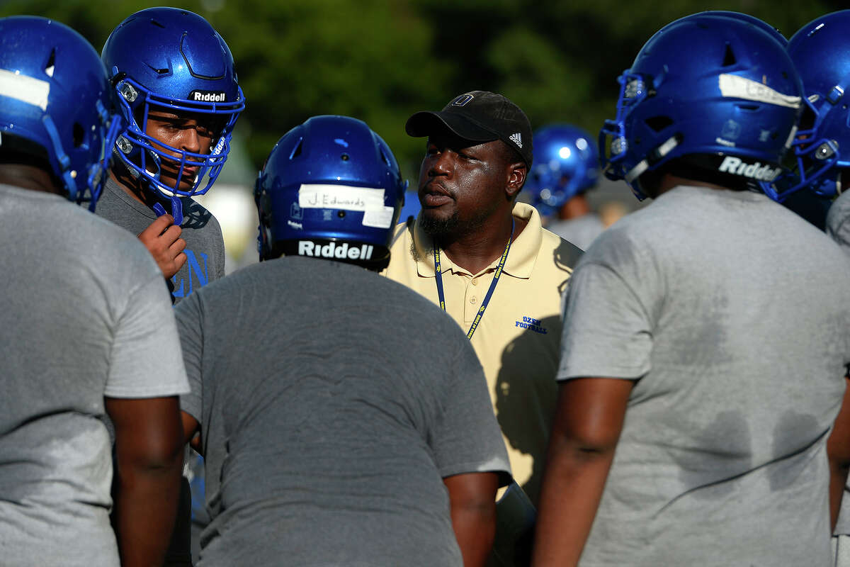 Ozen head football coach Ed Taylor talks with players during practice on Monday. Taylor is entering his second year coaching the Panthers after taking over late last summer. Photo taken Monday 8/14/17 Ryan Pelham/The Enterprise