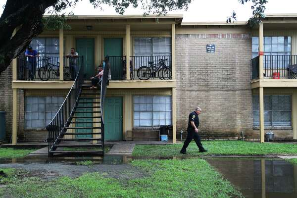 Houston Police Department officer Al Yanez, 51, walks away from an apartment building, Tuesday, Aug. 8, 2017, after he answered questions about the Texas law, known as Senate Bill 4, which bans Òsanctuary cities.Ó The law will take effect Sept. 1.