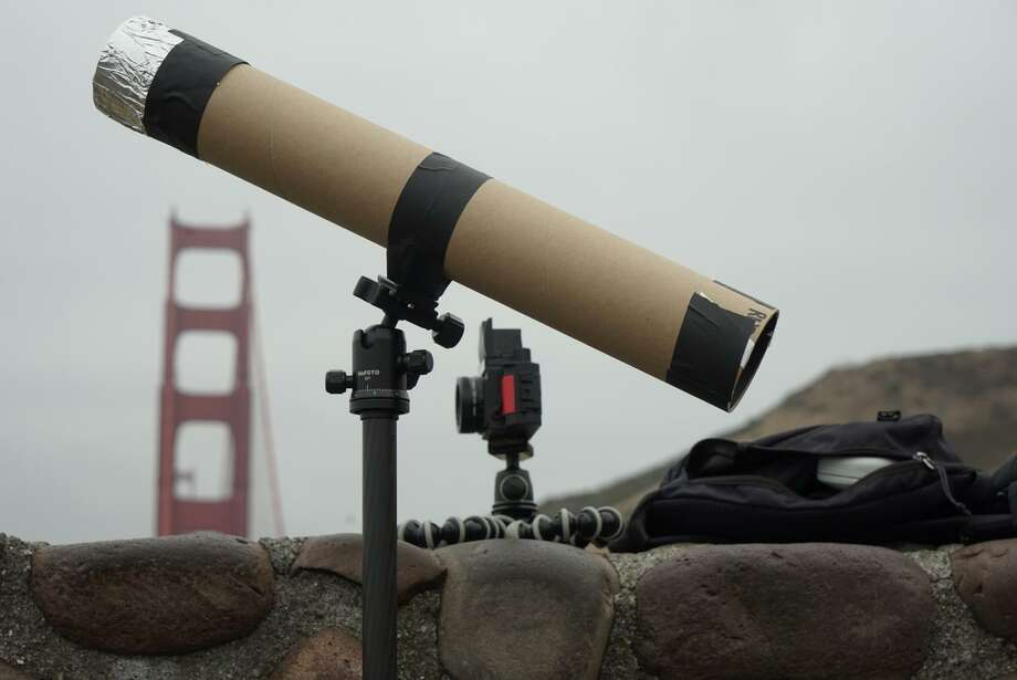 Will Ruby brought a specially-built cardboard tube to the Golden Gate Bridge vista point in hopes of viewing Monday's partial solar eclipse. The day's fog blocked the eclipse for much of the Bay Area. Photo: James Tensuan, Special To The Chronicle / /
