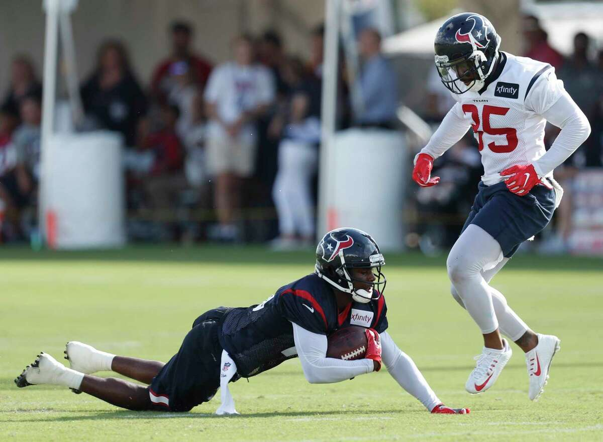 Houston Texans wide receiver Germone Hopper (16) is brought down by Houston Texans defensive back Eddie Pleasant (35) during training camp at The Methodist Training Center on Monday, Aug. 21, 2017, in Houston.