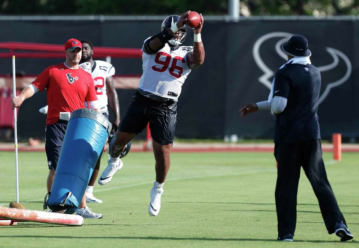 Houston Texans defensive tackle Eli Ankou (96) catches a football during training camp at The Methodist Training Center on Monday, Aug. 21, 2017, in Houston.