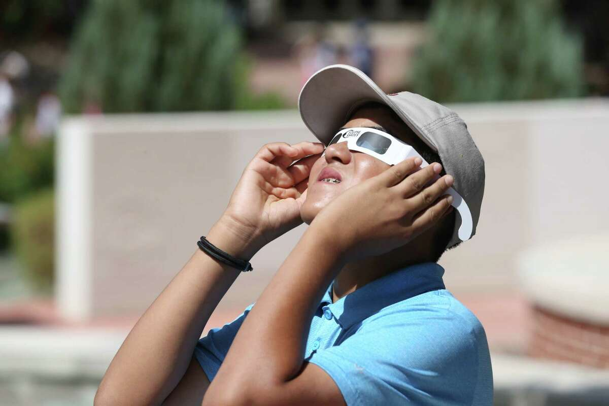 Christian Hernandez, 12, checks out the sun with viewing glasses at the San Antonio College Scobee Planetarium for the 2017 Eclipse, Monday, August 21, 2017. The partial eclipse will be around 60 percent at 1:10pm.
