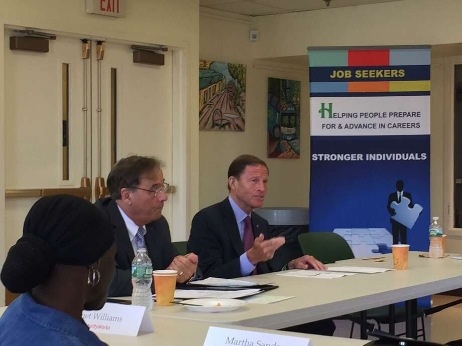 U.S. Sen. Richard Blumenthal, D-Conn., center, and Joe Carbone, CEO of The WorkPlace, a not-for-profit agency based in Bridgeport, host a roundtable discussion on a program that provides aid and training for older unemployed people. Photo: Contributed Photo
