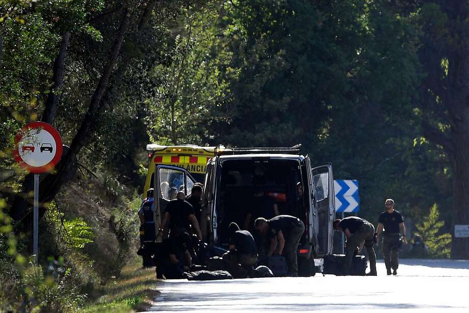 A bomb disposal team works at the site where Younes Abouyaaqoub was killed south of Barcelona. Photo: LLUIS GENE, AFP/Getty Images
