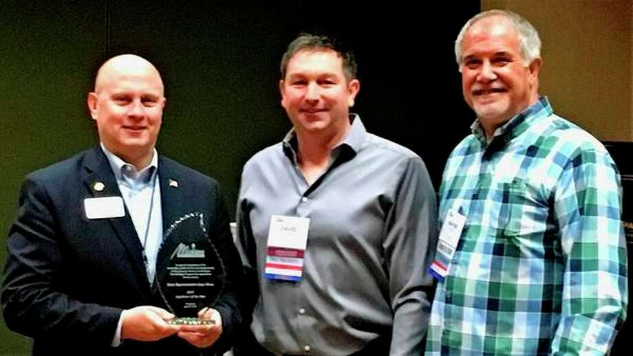 State Rep. Gary Glenn, R-Larkin Twp., left, has beennamed Legislator of the Year by the Michigan Propane Gas Association during the group's annual conference. Presenting the award were Dave Long, Marlette, center, MPGA president, and Wayne Kohley, Fruitport, chairman of MPGA's government relations committee. Brian Lincoln, Gary Shepherd and Jeremy Stanford, all of Stanford L.P. Gas in Midland, also serve as committee chairs for MPGA. The group said it honored Glenn for 'his commitment to a competitive free market and level playing field for production and sales of energy in Michigan.'