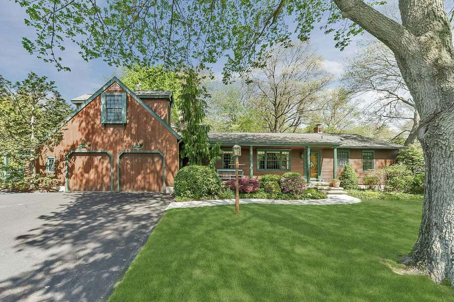 A modest ranch house at 104 Putting Green Road was expanded, renovated and re-imagined by the current owners who created a 2,446-square-foot custom-built colonial ranch.