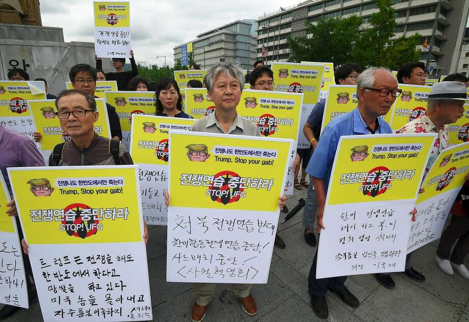 South Koreans opposed to the joint U.S.-South Korea military exercises demonstrate near the U.S. Embassy in Seoul. Photo: JUNG YEON-JE, AFP/Getty Images