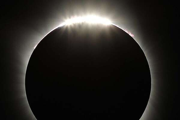 The Diamond Ring appears as the Moon passes beyond the edge of the sun during the Great American Solar Eclipse at Madras High School in Madras, Oregon, on Monday, August 21, 2017. The eclipse will be a total in certain parts of the United States from the East Coast to the West Coast.