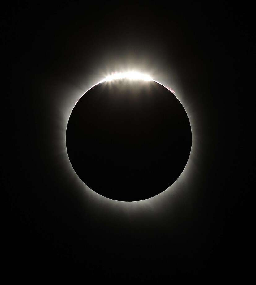 The Diamond Ring appears as the Moon passes beyond the edge of the sun during the Great American Solar Eclipse at Madras High School in Madras, Oregon, on Monday, August 21, 2017. The eclipse will be a total in certain parts of the United States from the East Coast to the West Coast. Photo: Carlos Avila Gonzalez, The Chronicle