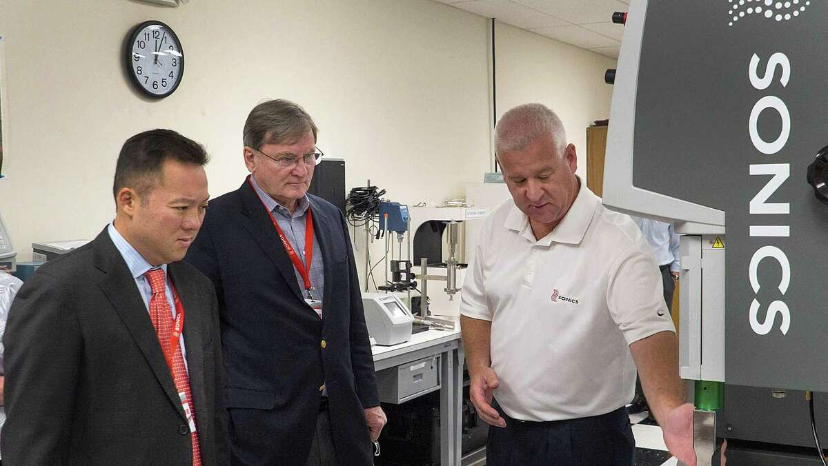 State Rep. William Tong, D-147, and Joe McGee, vice president of the Business Council of Fairfield County, watch a welding press demonstration by Brian Gourley, Sonics?' North American sales manager, welding product line, during an August 2017 visit to Sonics headquarters in Newtown, Conn. Tong and McGee are co-chairs of the state's Commission on Economic Competitiveness.