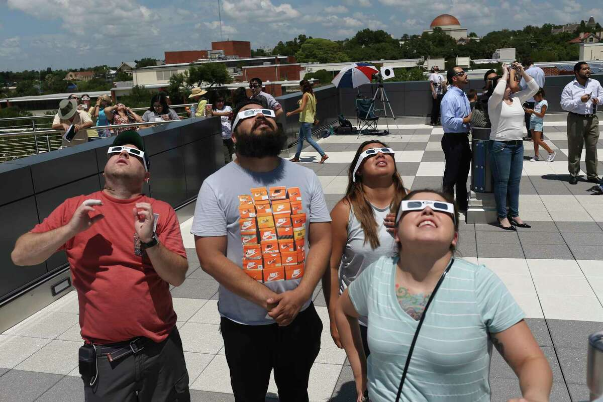 People watch the partial solar eclipse from the rooftop of the San Antonio College Scobee Observatory, Monday, August 21, 2017.
